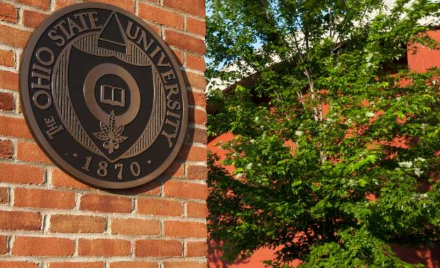 Photo of the University Seal on a brick wall