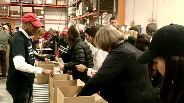 Image of President Drake at St. Mary's Food Bank